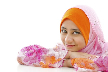 Pretty muslim woman smiling, on white background