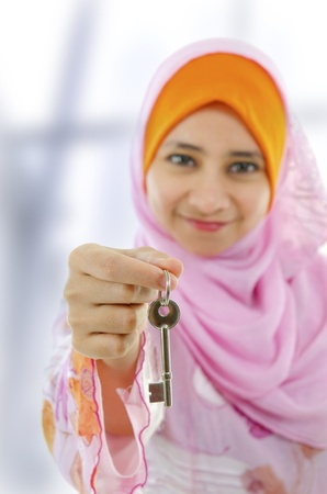 promotion girl: Muslim woman holding a new key