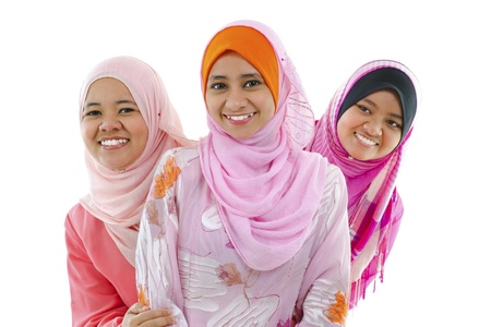 Happy Muslim women standing in row, on white background