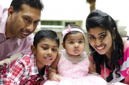 muslim baby girl: Happy Indian family having fun time at outdoor Stock Photo