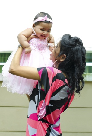 Indian mother playing with her baby girl photo