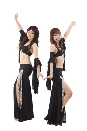 belly dance: Duet belly dancer posing on white