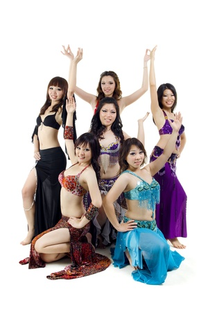 bellydance: Asian Belly dance troupe posing on white background