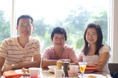 Happy Asian family dining at restaurant photo