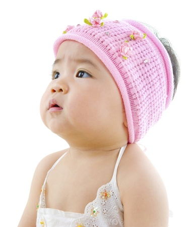 Curious Asian baby girl looking at blank side Stock Photo - 13402513