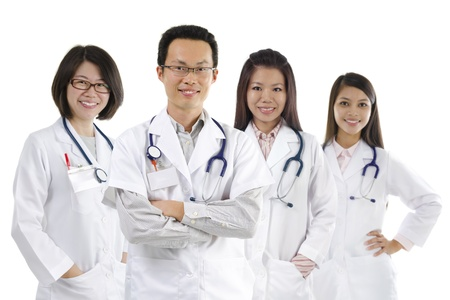 Asian medical team standing on white background photo