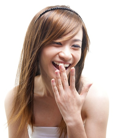 Laughing Asian woman covering her mouth on white background photo