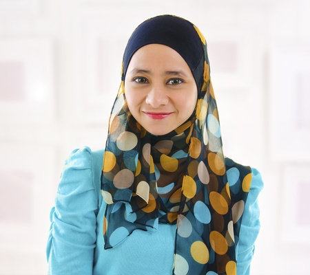 malay ethnicity: Beautiful Young Muslim girl smiling, indoor. Stock Photo