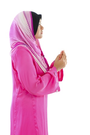 Female Muslim prayer on white background  photo