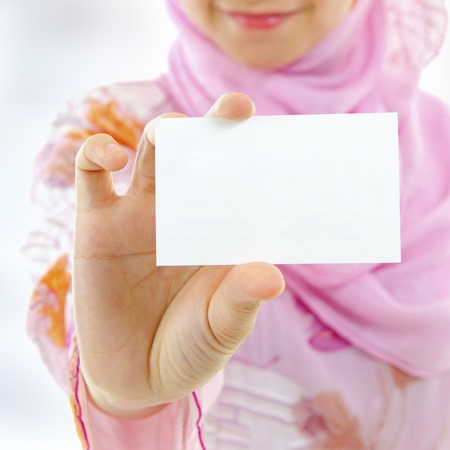 businesswoman card: Muslim female holding business card, focus on hand Stock Photo