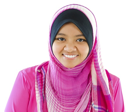 Young Muslim girl smiling on white background photo