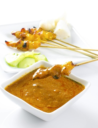 chili sauce: Delicious chicken satay on skewers