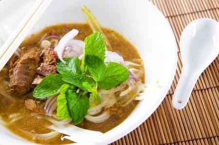 Famous Malaysian Spicy Soup Noodles, Penang Asam laksa photo