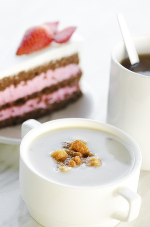 Mushroom Soup with Toast, strawberry cake and tea as background, natural morning sunlight. photo