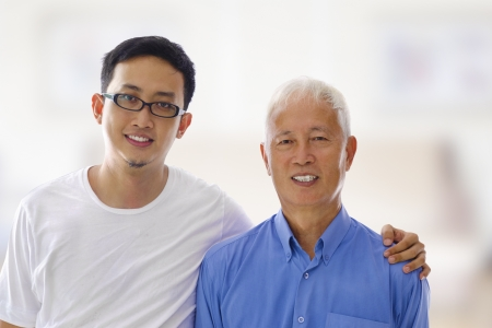 Asian Father and son portrait at indoor house photo