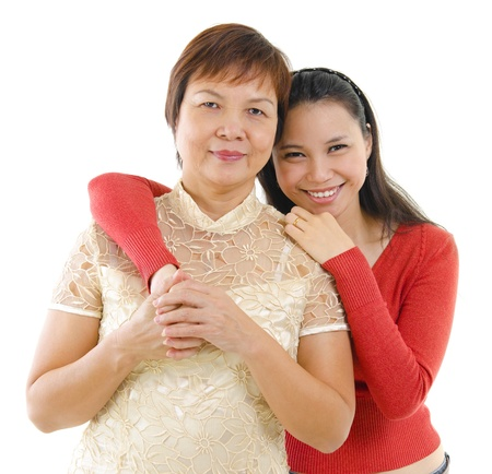 Mixed race daughter hugging her mother isolated on white background photo