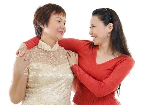 Mixed race Asian mother and daughter having conversation on white background photo