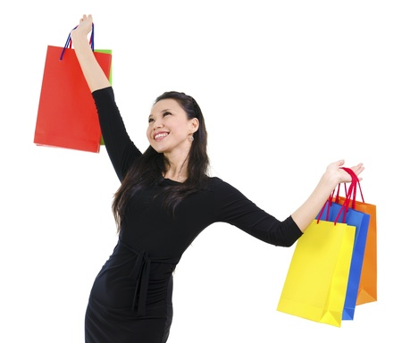 copysapce: Happy shopper holding shopping bag high isolated on white background Stock Photo