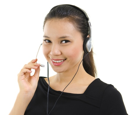 answering call: Friendly Customer Representative with headset smiling during a telephone conversation. Stock Photo
