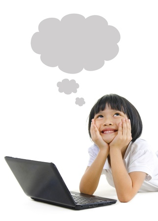 Pan Asian school girl using laptop and looking up photo