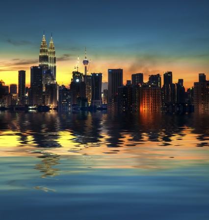 skyline at sunrise: Kuala Lumpur, the capital city of Malaysia, view with water reflection Stock Photo