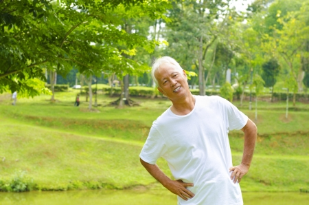 Retired Asian senior man exercising in park photo