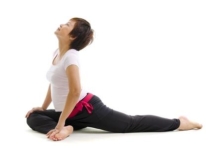 one senior adult woman: Mujer madura de Asia en el yoga, aislado en blanco Foto de archivo