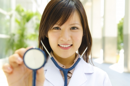 asian medical: Asian medical student with stethoscope in hand