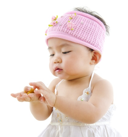 korean girl: Cute pan Asian baby girl eating on white background