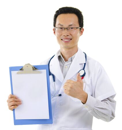 good news: Asian male doctor thumb up showing perfect medical test results Stock Photo