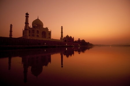 unesco world cultural heritage: Taj Mahal in sunset view, water reflection of yamuna river