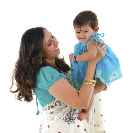 Happy Indian mother and daughter on white background photo