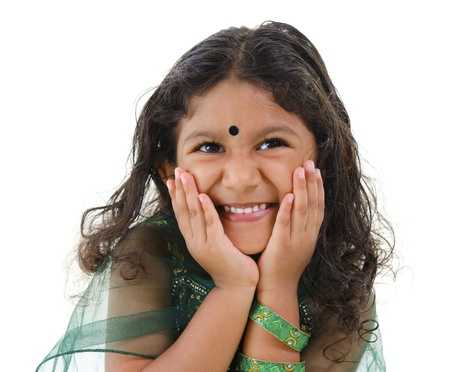 Young little Asian Indian girl smiling on white background photo