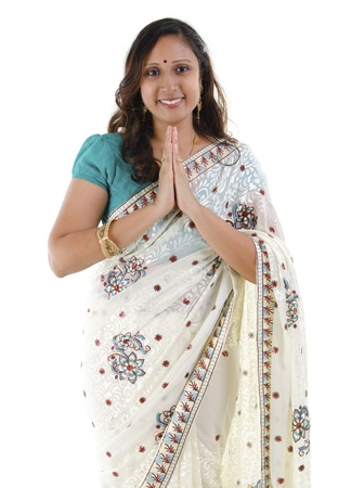 welcoming: Mid Adult Indian woman in a greeting pose, isolated white background Stock Photo