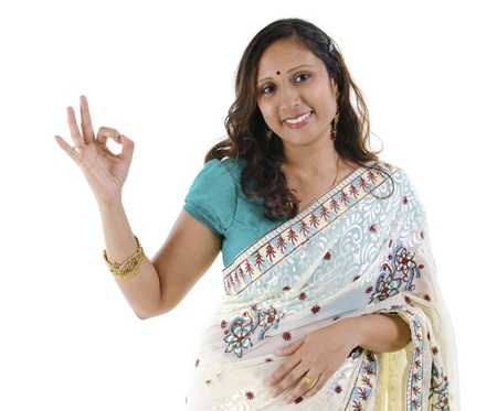 indian saree: Beautiful Indian woman showing okay hand sign on white background Stock Photo