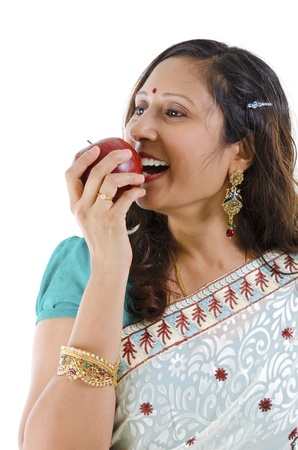 Healthy Indian woman eating red apple, isolated on white background photo