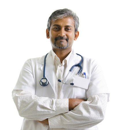Indian mature male doctor crossed arms on white background photo