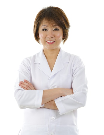 therapist: Mid Adult Asian beauty spa massage therapist woman standing isolated on white background Stock Photo