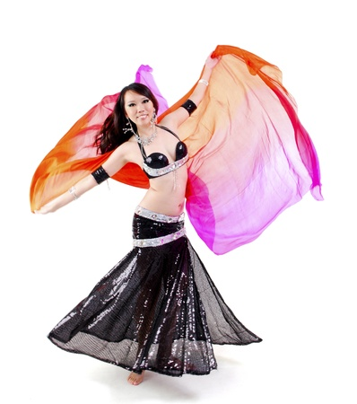 Belly dancer dancing with her veil