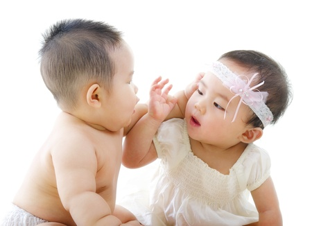 Two Asian babies having baby talk photo
