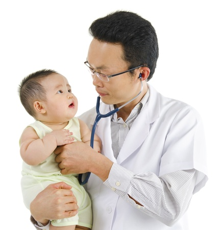 children's doctor: Childrens doctor exams infant with stethoscope