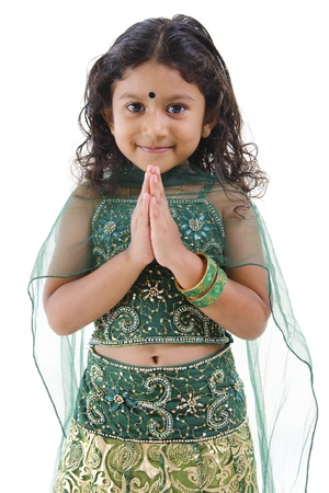 indian saree: Cute little Indian girl in a greeting pose, isolated white background