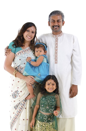 Happy traditional Indian family in traditional Indian costume standing on white background Stock Photo