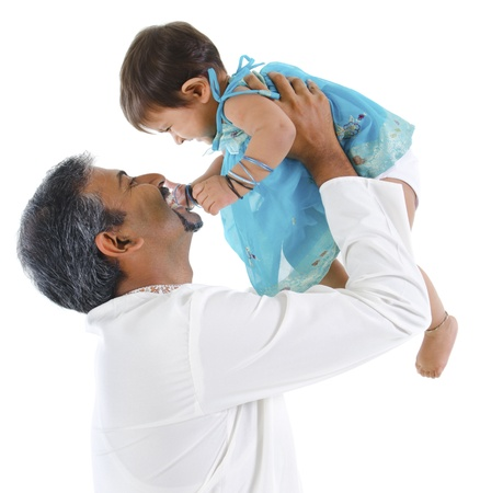 Mature traditional Indian father raise her baby girl up, isolated on with background Stock Photo - 14159214