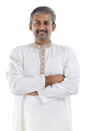 Confident mature traditional Indian man in kurta dhoti crossed arms isolated on white background