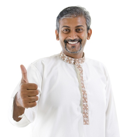 kurta: Excited thumb up Indian man in traditional costume kurta dhoti isolated on white background Stock Photo