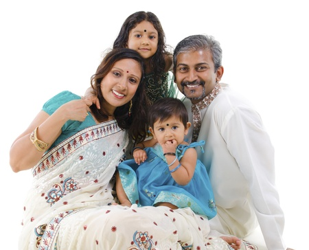 asian indian: Happy Indian family with two children in traditional costume sitting on white background Stock Photo