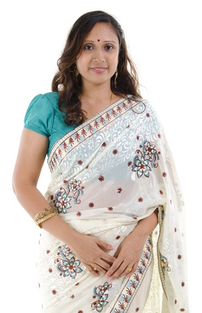 Portrait of a middle aged Traditional Indian woman in sari costume isolated on white background photo