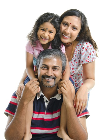 Happy Asian Indian family stacking on white background photo