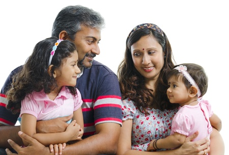 adult indian: Modern Indian family with two daughter having conversation on white background Stock Photo